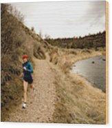 A Woman Jogging On A Dirt Trail Wood Print