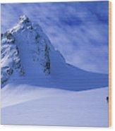 A Woman Ski Tours And Explores Wood Print