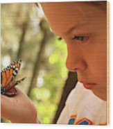 A Young Boy Holds A Stick Wood Print