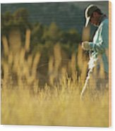 A Young Man Fly-fishing At Sunset Wood Print