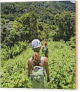 A Young Woman Hikes Through The Jungles Wood Print
