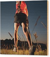 A Young Woman Runs Through A Grassy Wood Print