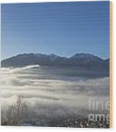 Alpine Village Under Sea Of Fog Wood Print