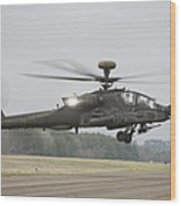 An Ah-64 Apache Helicopter In Midair Wood Print