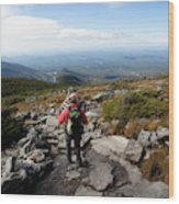An Athletic Female Hiker Hikes Wood Print