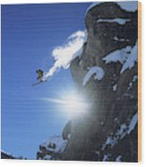 An Extreme Skier Jumps Off A Snowy Wood Print