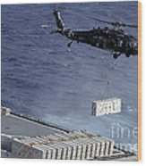 An Mh-60s Sea Hawk Helicopter Picks Wood Print