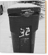 bag sticking out of litter waste bin covered in snow outside house in Saskatoon Saskatchewan Canada Wood Print by Joe Fox