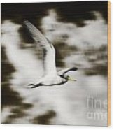 Bird Flying In The Clouds Wood Print