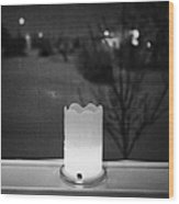 candle in the window looking out over snow covered scene in small rural village of Forget Saskatchew Wood Print