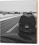cars waiting on train crossing trans-canada highway in winter outside Yorkton Saskatchewan Canada Wood Print by Joe Fox