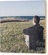 Caucasian Traveler Relaxing On Grass Outdoors Wood Print