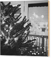 decorated christmas tree looking out of window to snow covered scene in small rural village of Forge Wood Print