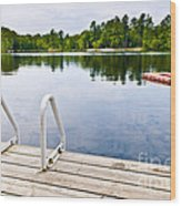 Dock On Calm Lake In Cottage Country Wood Print