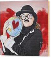 Eccentric Man Showing World Love By Cuddling Globe Wood Print