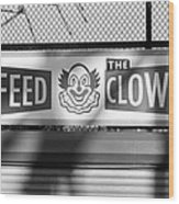 Feed The Clown In Black And White Wood Print
