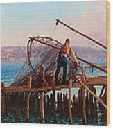 Fishermen Bringing In The Catch Wood Print
