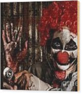 Frightening Clown Doctor Holding Amputated Hand  Wood Print