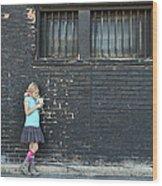 Girl Standing Next To Brick Wall Wood Print