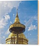 Golden Pagoda With Blue Sky At Wat Phra That Hariphunchai Wood Print