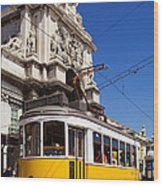 Lisbon's Typical Yellow Tram In Commerce Square Wood Print