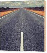 Long Straight Road With Gathering Storm Clouds Wood Print by Colin and Linda McKie
