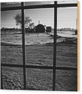 looking out through door window to snow covered scene in small rural village of Forget Saskatchewan  Wood Print