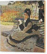 Madame Monet On A Garden Bench Wood Print by Claude Monet