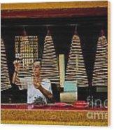 Man Lighting Incense In Chinese Temple Vietnam Wood Print