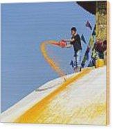 Man Throwing Orange Paint On Boudhanath Stupa Wood Print
