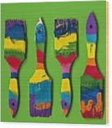 Multicolored Paint Brushes On Green Background Wood Print