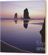 Needles Silhouetted Cannon Beach Oregon Wood Print