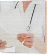 Nurse With Paperwork Wood Print