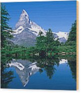 Reflection Of A Snow Covered Mountain Wood Print