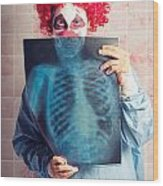 Scary Clown Peeking Behind X-ray. Funny Bones Wood Print