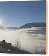 Sea Of Fog With Sunbeam Wood Print