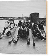 snowmobiles parked in Kamsack Saskatchewan Canada Wood Print by Joe Fox