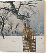 Snowshoes Leaning Against Birch Tree Snowscape Wood Print