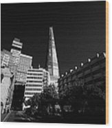 the shard building towering over local buildings including guys hospital in southwark London England Wood Print