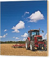 Tractor In Plowed Field Wood Print