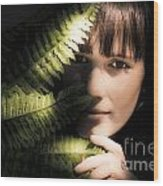 Woman Hiding Behind Fern Leaf Wood Print