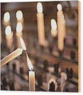 Woman Lighting Prayer Candle Wood Print