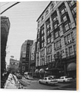 yellow cabs wait outside Macys at Broadway and 34th Street Herald Square new york Wood Print