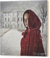 Young Woman Wearing Hooded Cape In Snowy Winter Scene Wood Print