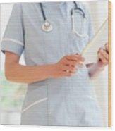 Nurse Using A Tablet Computer Wood Print