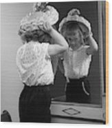 1950s Little Girl Trying On Hat Looking Wood Print