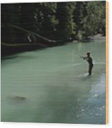 A Man Casts In A River Wearing Waders Wood Print