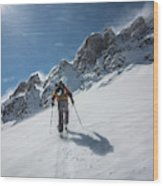 A Man Ski Touring In The Mountains Wood Print