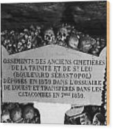 A Marker With Skulls And Bones In The Catacombs Of Paris France Wood Print