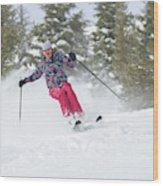 A Skier Descends A Snowy Slope Wood Print